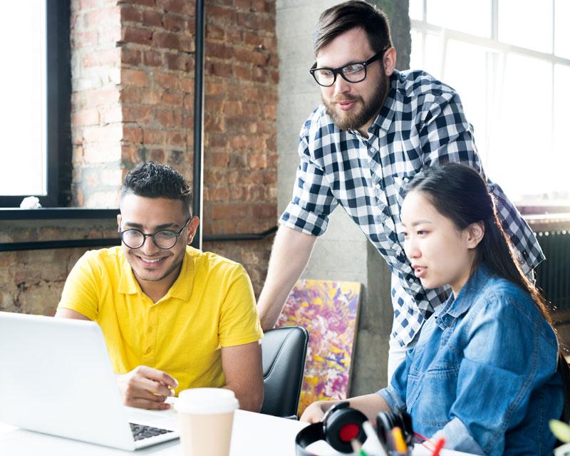 creative-business-team-using-computer-in-office-3GWRXTU