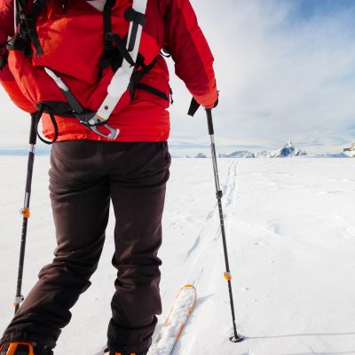 mountaineer-exploring-a-glacier-with-the-skis-PZWYW5Q